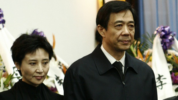 Gu Kailai, the wife of disgraced Chinese politician Bo Xilai, will stand trial on charges related to the murder of British businessman Neil Heywood. Here, the couple is shown in 2007 attending Bo's father's funeral. (Reuters/Landov)