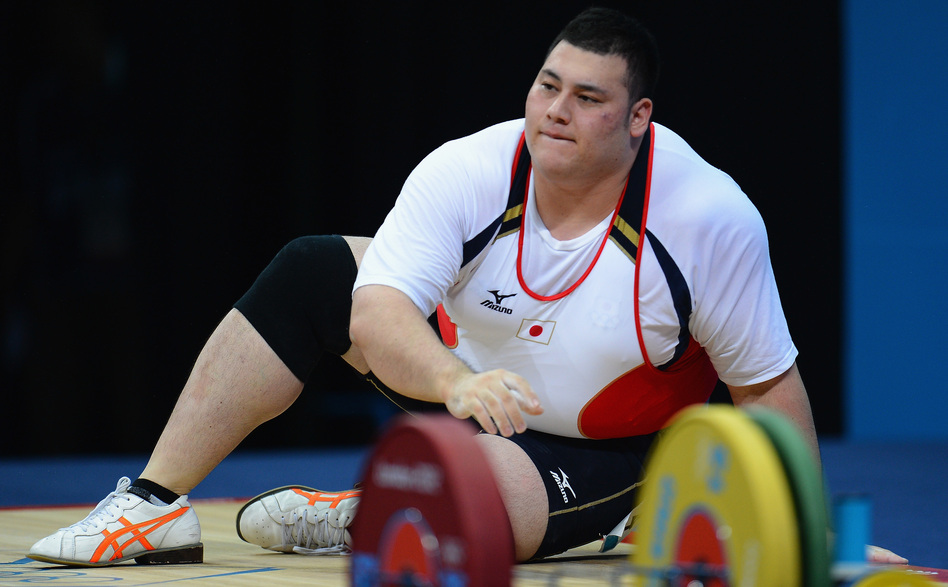 Weightlifter Kazuomi Ota of Japan takes a moment after failing to lift the required weight in the men's +105kg  final in London. At 6 feet and 324 pounds, Ota is one of the largest Olympians.
