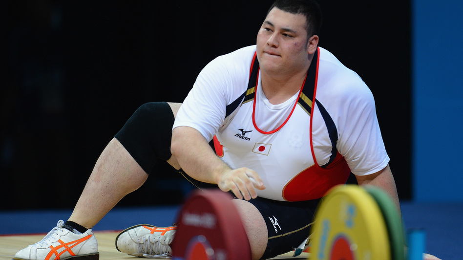 Weightlifter Kazuomi Ota of Japan takes a moment after failing to lift the required weight in the men's +105kg  final in London. At 6 feet and 324 pounds, Ota is one of the largest Olympians. (Getty Images)