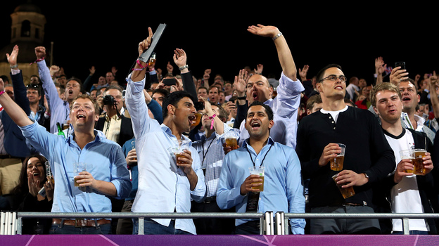 Fans make some noise as they watch Olympic women's beach volleyball at Horse Guards Parade in London. There seems to be little consistency in which sports require quiet from spectators. (Getty Images)