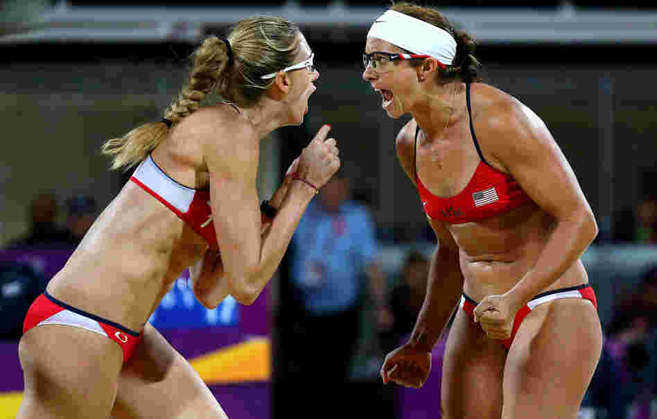 Americans Kerri Walsh Jennings (left) and Misty May-Treanor yell after winning a record third-straight gold medal in women's beach volleyball, at the Horse Guard's Parade in London.