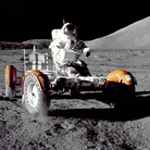 Apollo 17 commander Eugene A. Cernan takes a Lunar Roving Vehicle for a spin at the Taurus-Littrow landing site during the 1972 mission.