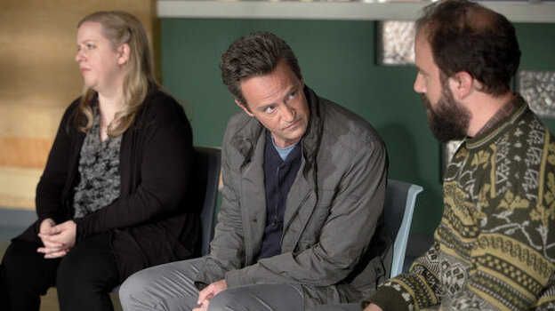Sarah Baker as Sonia, Matthew Perry as Ryan King, and Brett Gelman as Mr. K in the new comedy Go On.