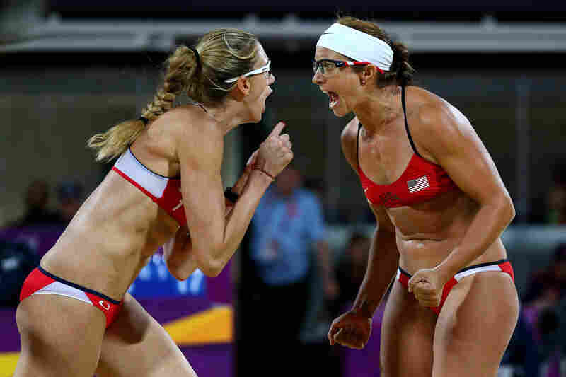Kerri Walsh Jennings (left) and Misty May-Treanor of the United States celebrate winning the gold medal in the women's beach volleyball finals against April Ross and Jennifer Kessy of the United States.