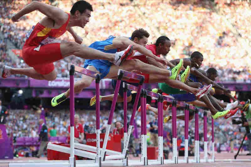 Wenjun Xie of China (left), Konstantin Shabanov of Russia, Aries Merritt of the U.S., Andrew Turner of Great Britain and Selim Nurudeen of Nigeria compete in the men's 110-meter hurdles semifinal.