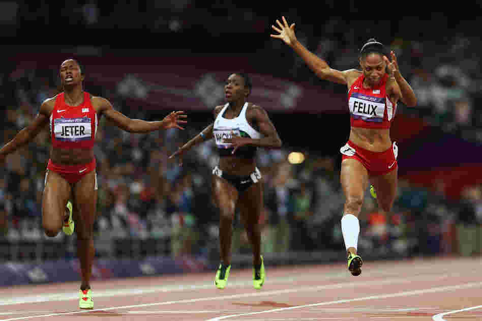 Allyson Felix of the U.S. crosses the finish line ahead of Murielle Ahoure of Cote d'Ivoire and Carmelita Jeter of the U.S. to win the women's 200-meter final.