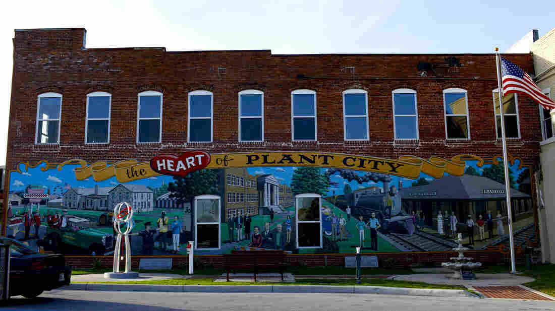 Plant City, Fla., claims to be the winter strawberry capital of the world. Here, a mural celebrating its past decorates the downtown.