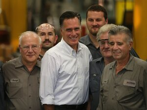 Republican presidential candidate Mitt Romney poses for a picture with workers during a campaign event at Acme Industries on August 7 in Elk Grove Village, Ill.