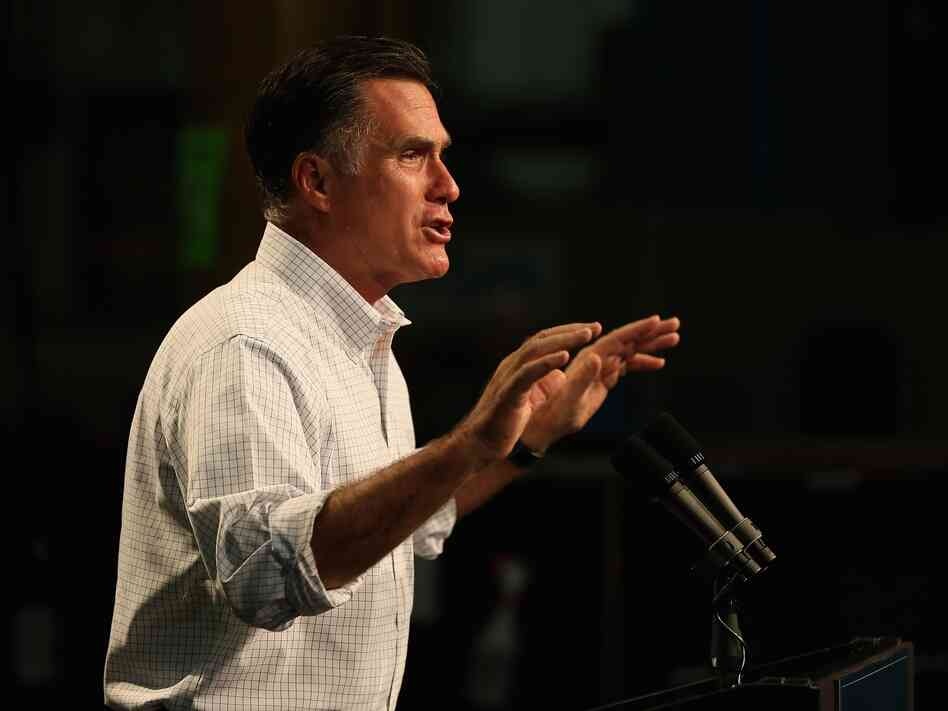 Republican presidential candidate Mitt Romney speaks to workers during a campaign event at Acme Industries on August 7 in Elk Grove Village, Ill.