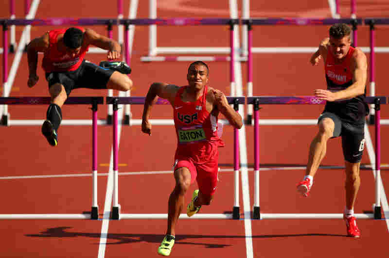Gonzalo Barroilhet of Chile (left), Ashton Eaton of the U.S. and Rico Freimuth of Germany compete during a men's decathlon 110-meter hurdles heat. Eaton won gold in the decathlon.