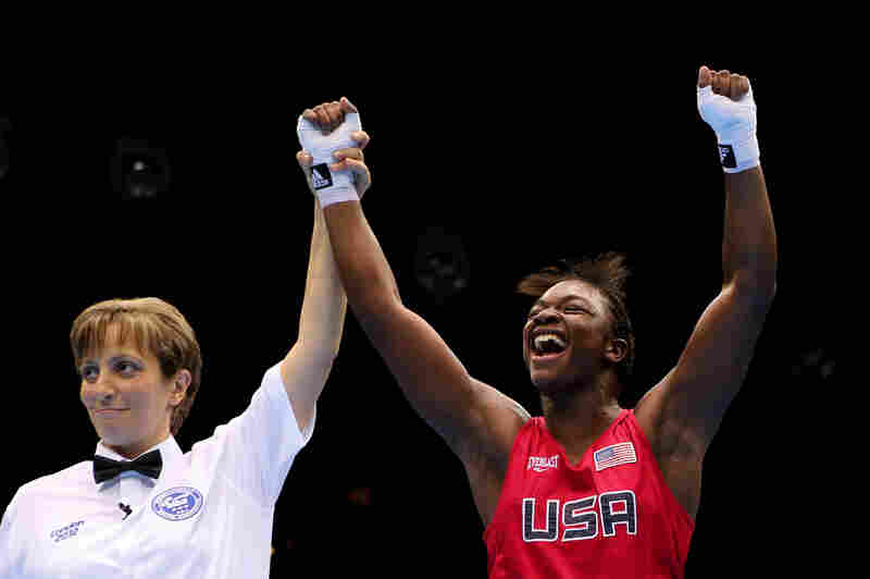 Referee Kheira Sidi Yakoub announces American Claressa Shields the winner over Nadezda Torlopova of Russia in the women's middleweight boxing final.