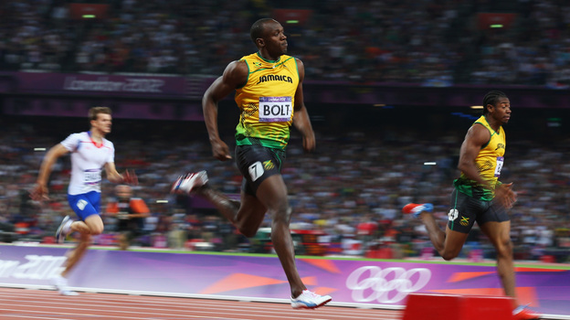 Usain Bolt of Jamaica crosses the finish line ahead of Yohan Blake of Jamaica to win gold during the Men's 200m Final. (Getty Images)