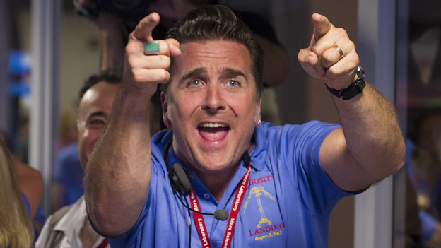 Adam Steltzner, the leader of the rover's entry, descent and landing engineering team, cheers after Curiosity touched down safely on Mars on Sunday. (Getty Images)