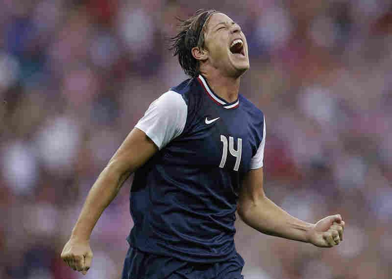 U.S. forward Abby Wambach celebrates a goal by teammate Carli Lloyd during the gold medal soccer match against Japan. The U.S. won 2-1.