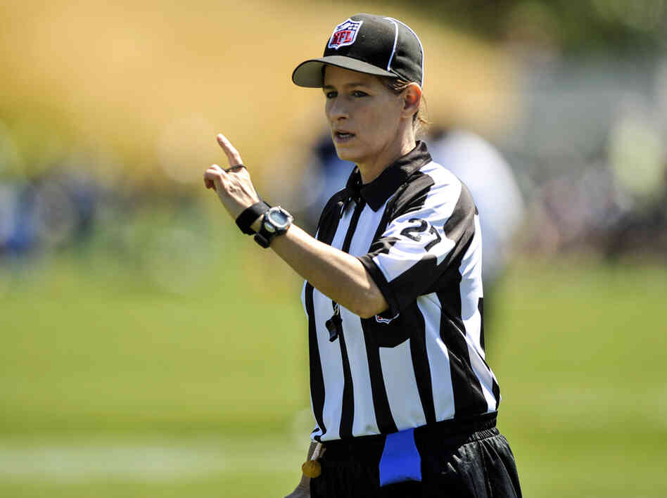 In this photo taken on Saturday, Aug. 4, 2012, and provided by the Seattle Seahawks, NFL official Shannon Eastin works during the Seahawks NFL football training camp in Renton, Wash.