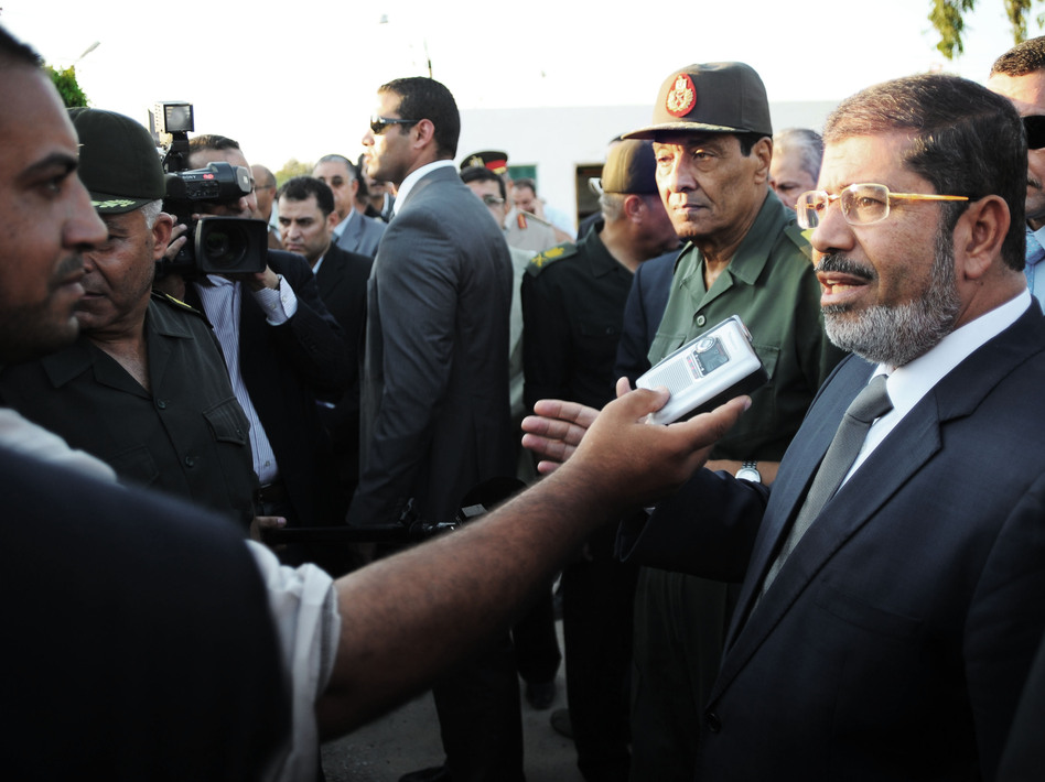 Egyptian President Mohammed Morsi (right) speaks to the media on Aug. 6 in El Arish, Egypt. He has already been engaging with the public more regularly than his predecessor.