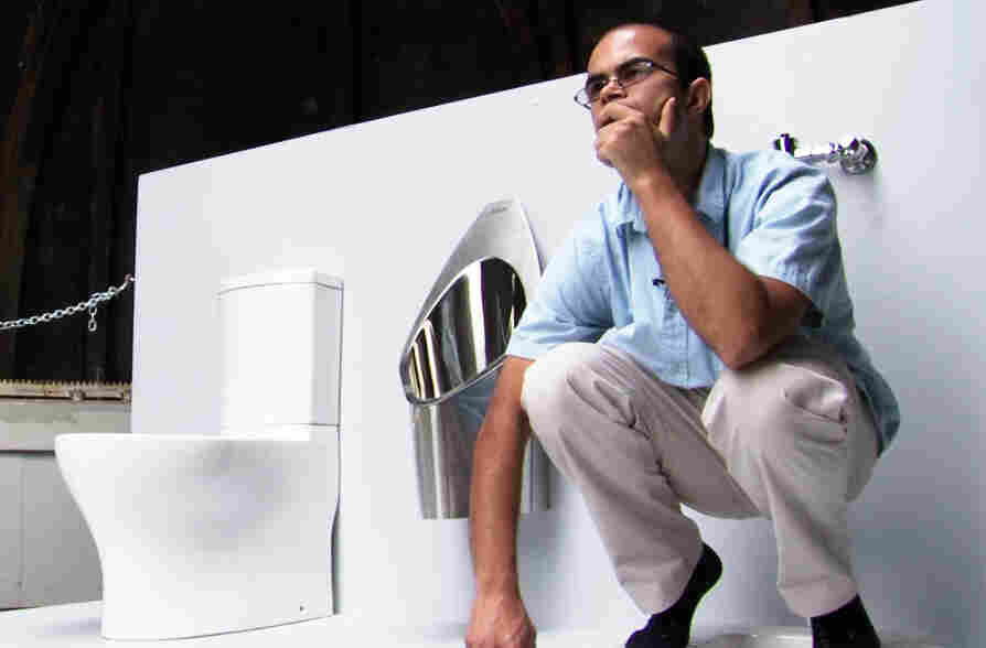 Graduate student Clement Cid sits atop the solar-powered toilet he helped to build at the California Institute of Technology in Pasadena, Calif. Underneath the platform, the toilet converts waste into fertilizer. The Calt