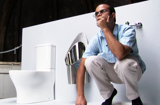 Graduate student Clement Cid sits atop the solar-powered toilet he helped to build at the California Institute of Technology in Pasadena, Calif. Underneath the platform, the toilet converts waste into fertilizer. The Caltech team will use fake feces to demonstrate the toilet's features next week at the Bill & Melinda Gates Foundation offices.