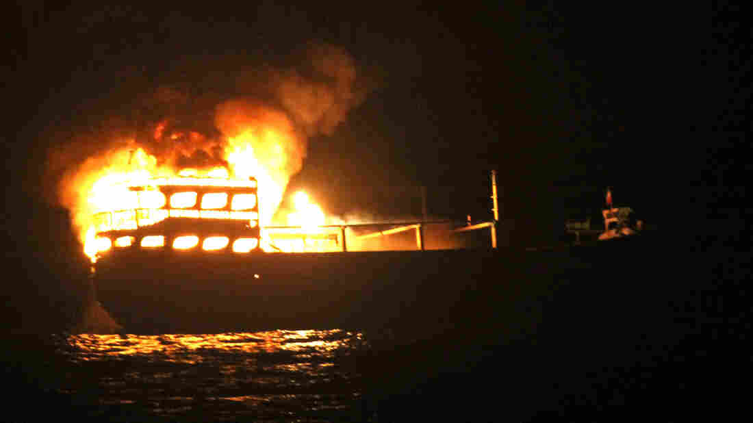The burning dhow from which the U.S. Navy says it rescued 10 Iranians on Wednesday in the Gulf of Oman.