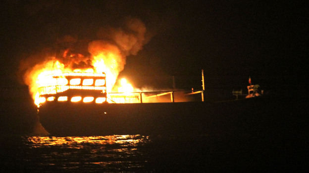 The burning dhow from which the U.S. Navy says it rescued 10 Iranians on Wednesday in the Gulf of Oman. (U.S. Navy)
