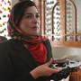 Soraya Paksat of Voice of Afghan Women holds a knife that was confiscated from a woman who came to visit a young relative in one of the group's shelters. The woman intended to kill the girl for fleeing an abusive father.
