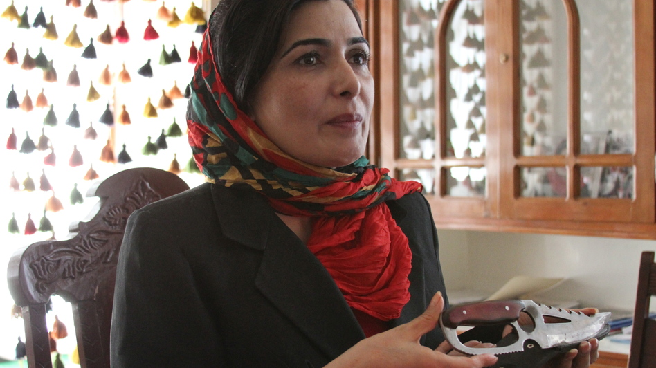Soraya Paksat of Voice of Afghan Women holds a knife that was confiscated from a woman who came to visit a young relative in one of the group's shelters. The woman intended to kill the girl for fleeing an abusive father. (NPR)