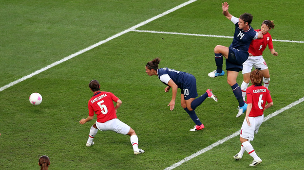 American Carli Lloyd heads in a goal in the first half to put the U.S. up 1-0 against Japan in the Olympic gold medal match. (Getty Images)