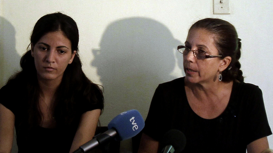 Ofelia Acevedo (right), the widow of Oswaldo Paya, and her daughter Rosa Maria Paya hold a news conference in Havana earlier this month. Acevedo says she doesn't believe her husband's death was an accident.