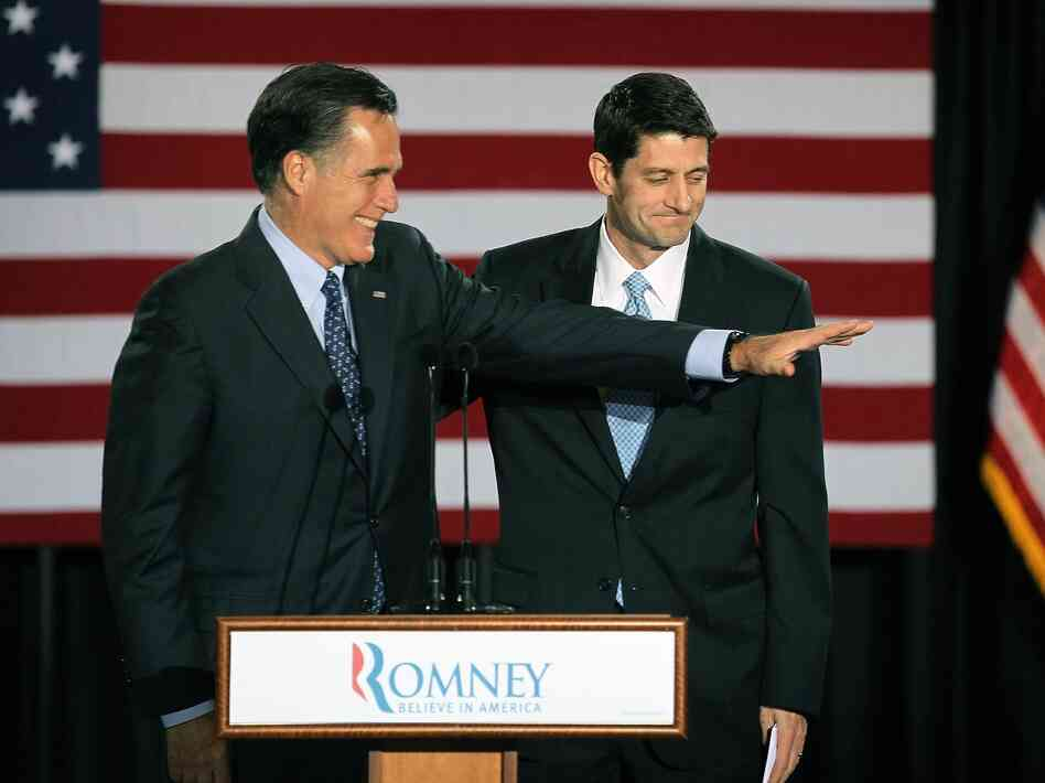 Republican presidential candidate Mitt Romney is introduced by Wisconsin Congressman Paul Ryan at an election-night rally on April 3 in Milwaukee, Wis.