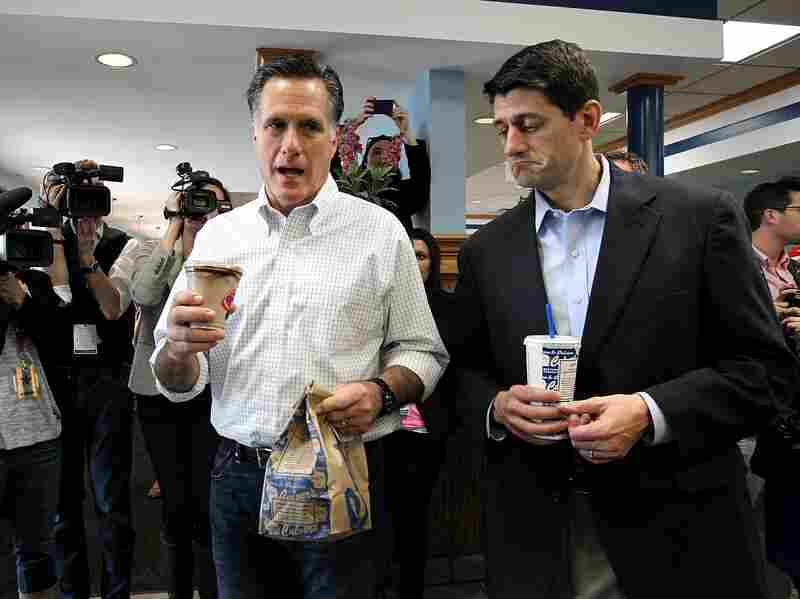 Republican Presidential candidate Mitt Romney and Rep. Paul Ryan, R-WI, hold bags of food at a Culver's restaurant on April 1 in Johnson Creek, Wis.