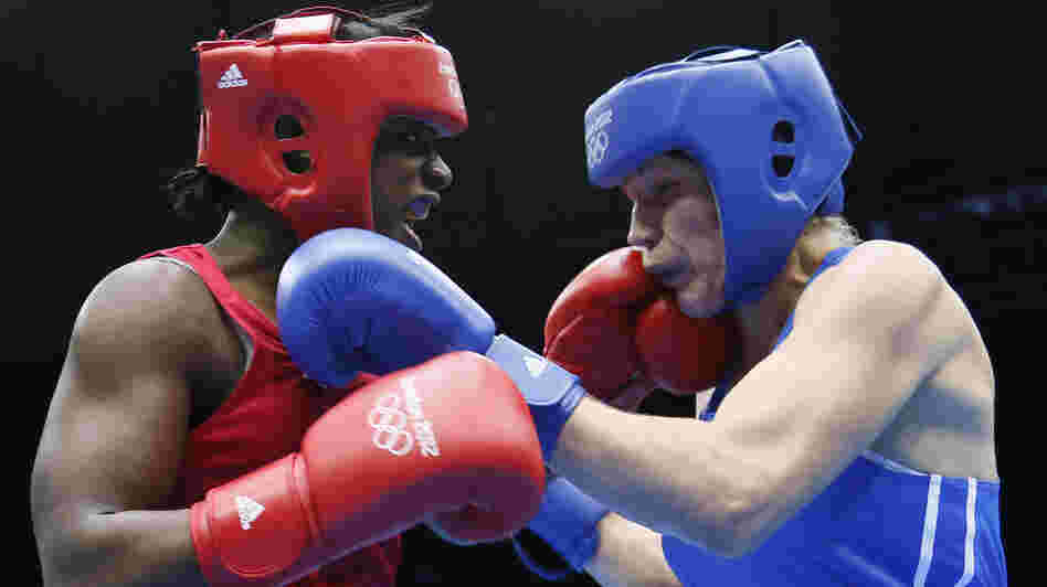 U.S. boxer Claressa Shields (left) lands a punch on Nadezda Torlopova of Russia during the women's boxing middleweight final at the ExCel Arena in London. Shields, 17, won the first-ever gold medal in the event.