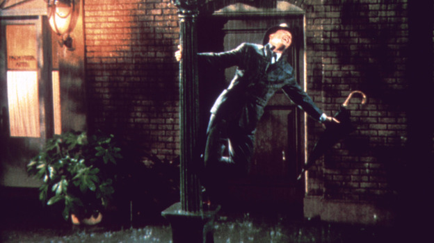 Gene Kelly stars as Don Lockwood in Singin' in the Rain. In celebration of the 1952 musical's 60th birthday, a newly restored print was released in theaters for a one-night public screening, and a new edition has been released on DVD and Blu-Ray. (Warner Home Video)