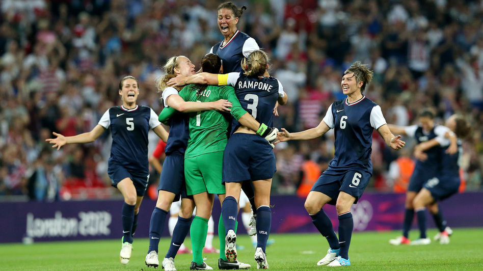 Hope Solo (in green), Shannon Boxx (top), Christie Rampone, Amy LePeilbet (right), and Kelley O'Hara (left) celebrate the U.S. women's soccer team's gold medal, after defeating Japan, 2-1, in London. (Getty Images)