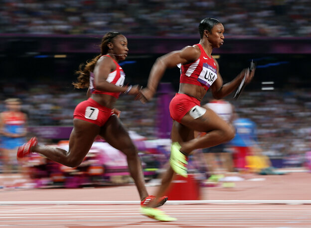 Carmelita Jeter of the United States receives the rel