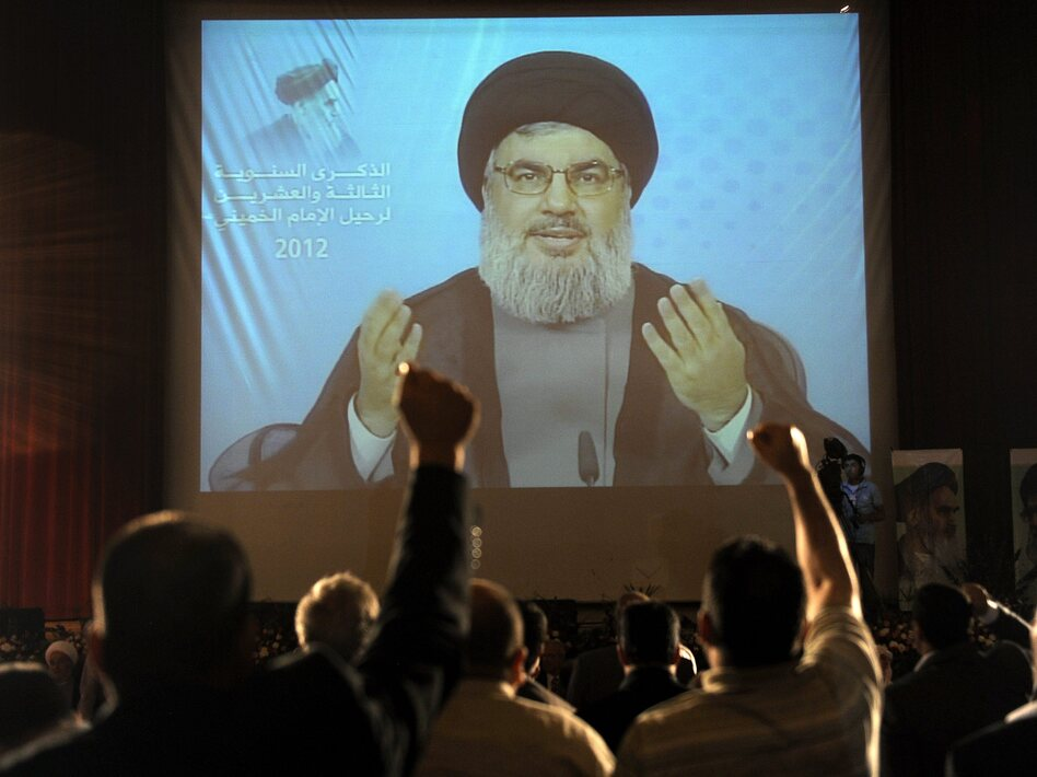 Hezbollah leader Sayyed Hassan Nasrallah, seen here delivering a speech via video in Beirut in June, has dismissed Assir's calls for disarmament. (EPA /Landov)