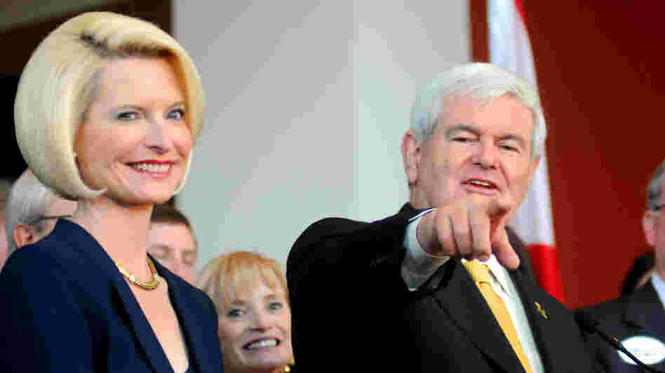 Former House Speaker Newt Gingrich, accompanied by his wife Callista, speaks at a rally in Montgomery, Ala., on March 7.