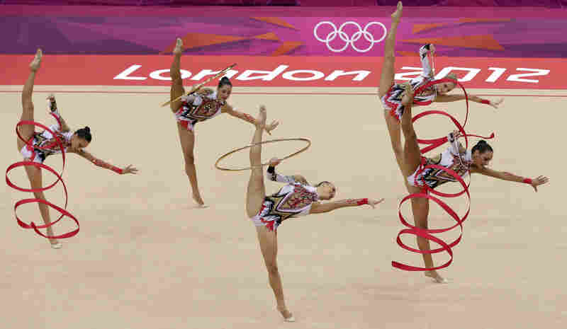 The team from Italy performs during the rhythmic gymnastics group all-around qualifications.