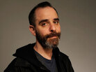 David Rakoff, the author of Half Empty, Don't Get Too Comfortable and Fraud, was a frequent contributor to This American Life. He died Thursday at the age of 47.
