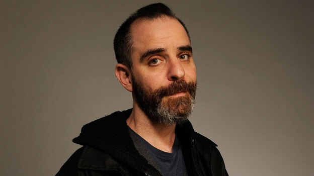David Rakoff, the author of Half Empty, Don't Get Too Comfortable and Fraud, was a frequent contributor to This American Life. He died Thursday at the age of 47. (Getty Images)
