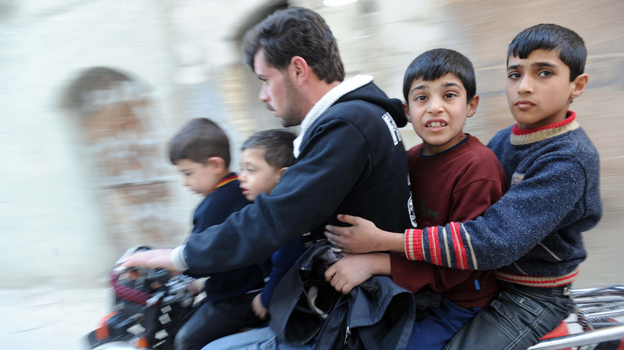 In northwestern Syria earlier this year, this man and boys fled fighting. (AFP/Getty Images)