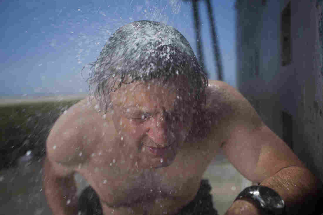 Shower or meteor shower? Joe Palca ducks through an outdoor shower in Venice Beach, Calif., to help illustrate how Earth passes through trails of space debris.