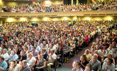 An auditorium full of his own face: the sold-out crowd offering a familiar welcome just as Carl came on stage.