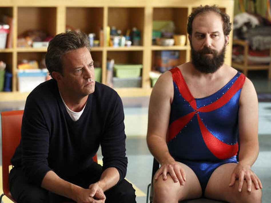 Matthew Perry and Brett Gelman of NBC's <em>Go On</em> appear in a promo shot especially for the Olympics.