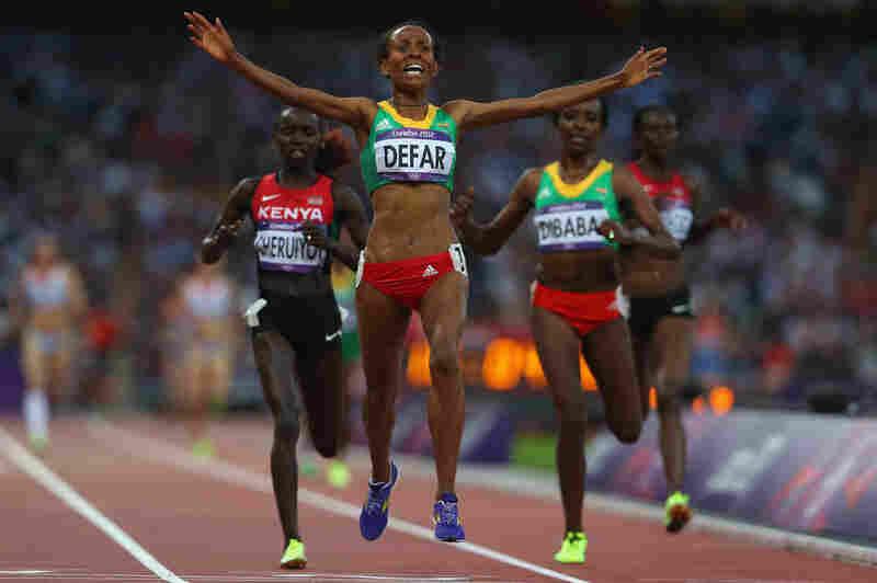 Meseret Defar of Ethiopia celebrates winning gold in the women's 5,000 meters.
