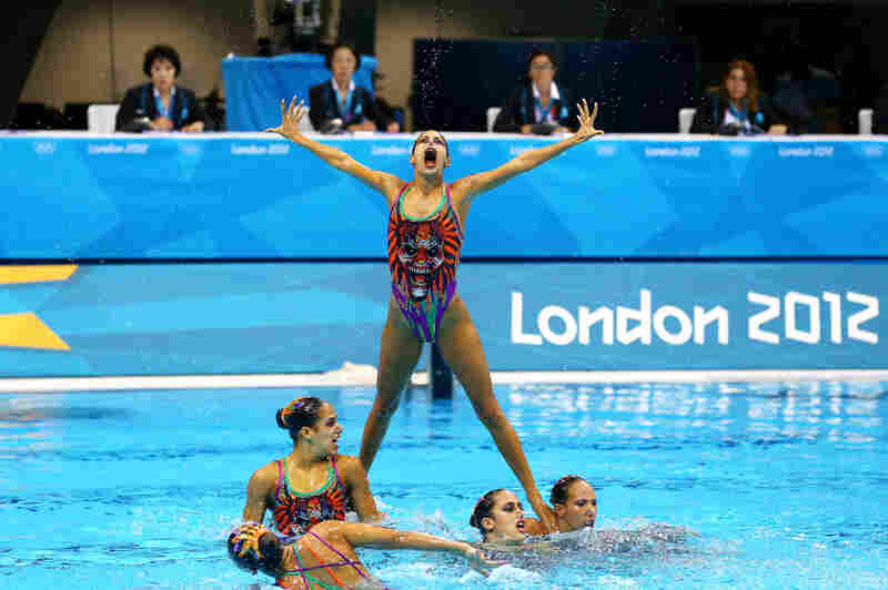 Egypt competes in the team synchronized swimming free routine final.