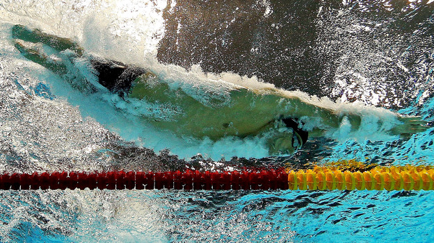 Phelps dives into the pool for his last Olympic race. He says that his plans for post-Olympic life include finally seeing the cities he's competed in. (Getty Images)