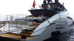 A foreign yacht is berthed at Porto Santo Stefano. Italian police have been raiding ports to check if yacht owners have been paying enough taxes.