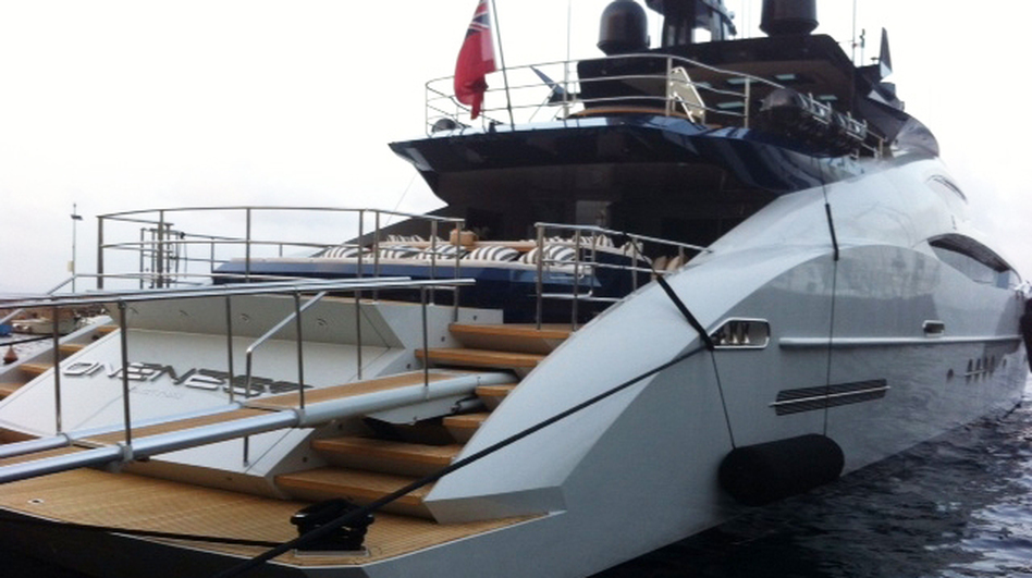A foreign yacht is berthed at Porto Santo Stefano. Italian police have been raiding ports to check if yacht owners have been paying enough taxes. (NPR)