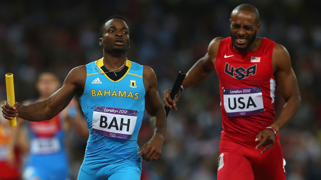 Ramon Miller (left) of the Bahamas crosses the finish line ahead of Team USA's Angelo Taylor to win the 4x400m relay gold medal at the London 2012 Olympics. (Getty Images)