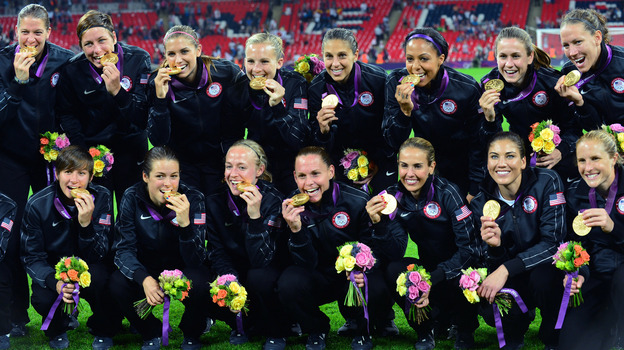 The U.S. women's soccer team won gold Thursday, in a victory that also kept the American women far ahead of the men in the number of medals won at the London Games: 100 to 59. (AFP/Getty Images)